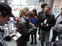 Yoshinori Ono Sharing his me with fans at the London St Pancras 3DS StreetPass Event (4)