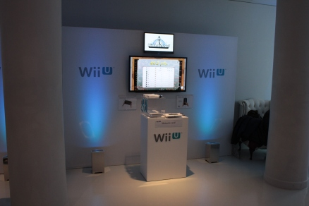 A demo unit of a white Wii U showing Nintendo Land