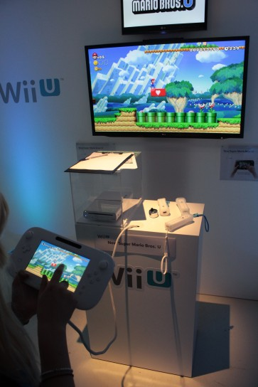 Katy creating a platform to assist another plater on New Super Mario Bros U on the Wii U