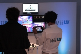 One of the Wii U demo staff looks around for targets for her bow in the Zelda Nintendo Land game on the Wii U